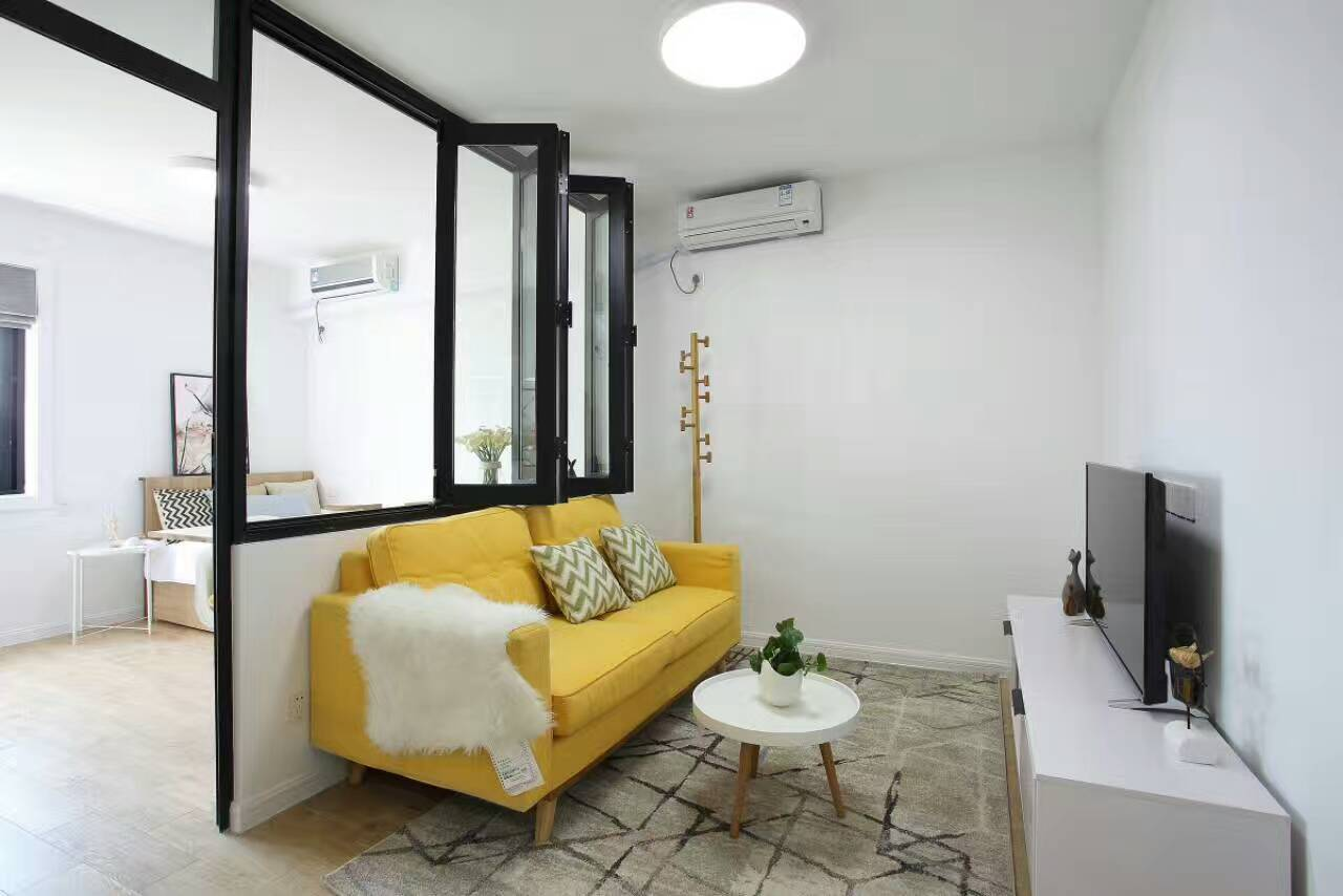 XUHUI:Gaoan road.Bright and Decent 2 bedoom flat with1  bath.L10/P=16000RMB.